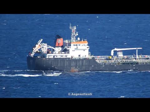 Hellenic Coast Guard RIB escorting Turkish flag oil-chemical tanker Zuga in Chios Strait.