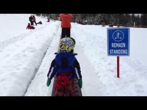 Ryan Going Up On Magic Carpet In China Peak Ski Resort