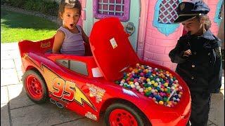 Layla plays with Lightning McQueen ride on and fills up with Gumballs