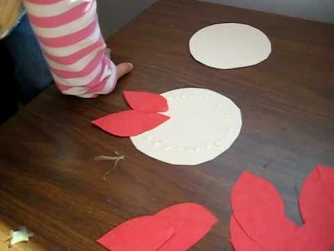 Christmas. Arts And Crafts Activity: Red Color Paper Poinsettia Flower Idea  For Kids.