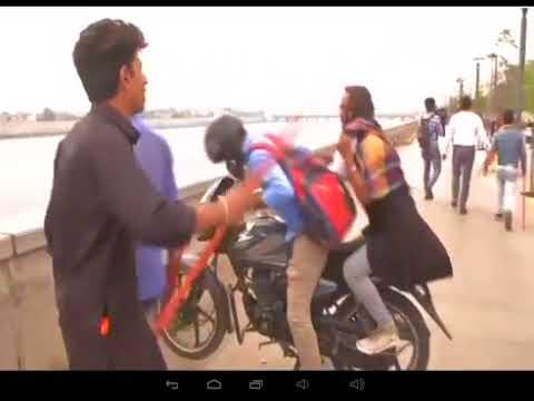 Valentine's Day | activists harass couples on Ahmedabad's Sabarmati Waterfront | NEWS INDIA TELUGU