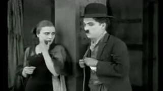 Edna Purviance flirts and dances with Charlie Chaplin