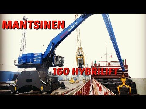 Mantsinen Hybrilift 160 loading a ship with wrapped bales