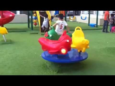 Children Playing In Park On SeeSaw, Slides, Roundabout Merry-Go-Round Spin By JeannetChannel