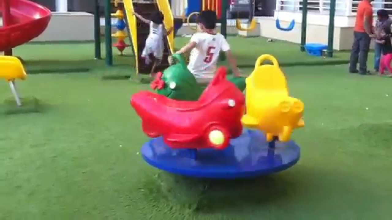 Children Playing In Park On Seesaw Slides Roundabout