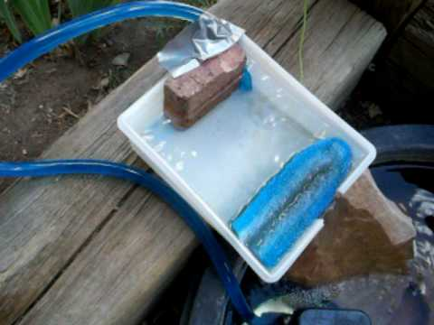 Home made pond filter youtube for Pond water filtration systems home