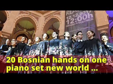 20 Bosnian hands on one piano set new world record
