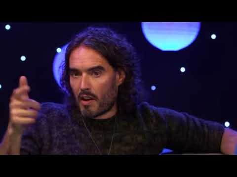 Russell brand long wavy casual hairstyle.