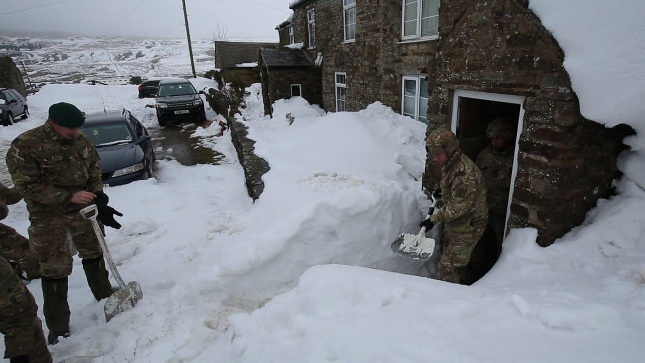 RAF flies supplies to snowbound Cumbrian residents – video