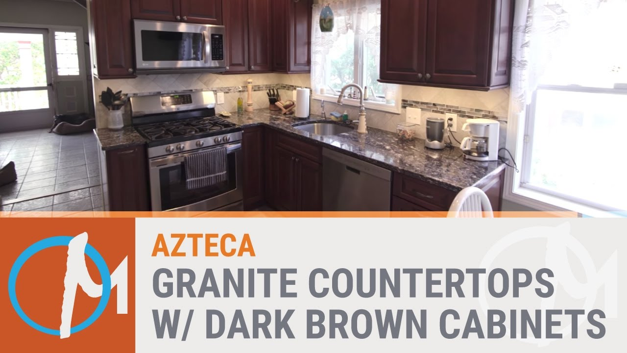 Azteca Granite Counters With Dark Brown Cabinets