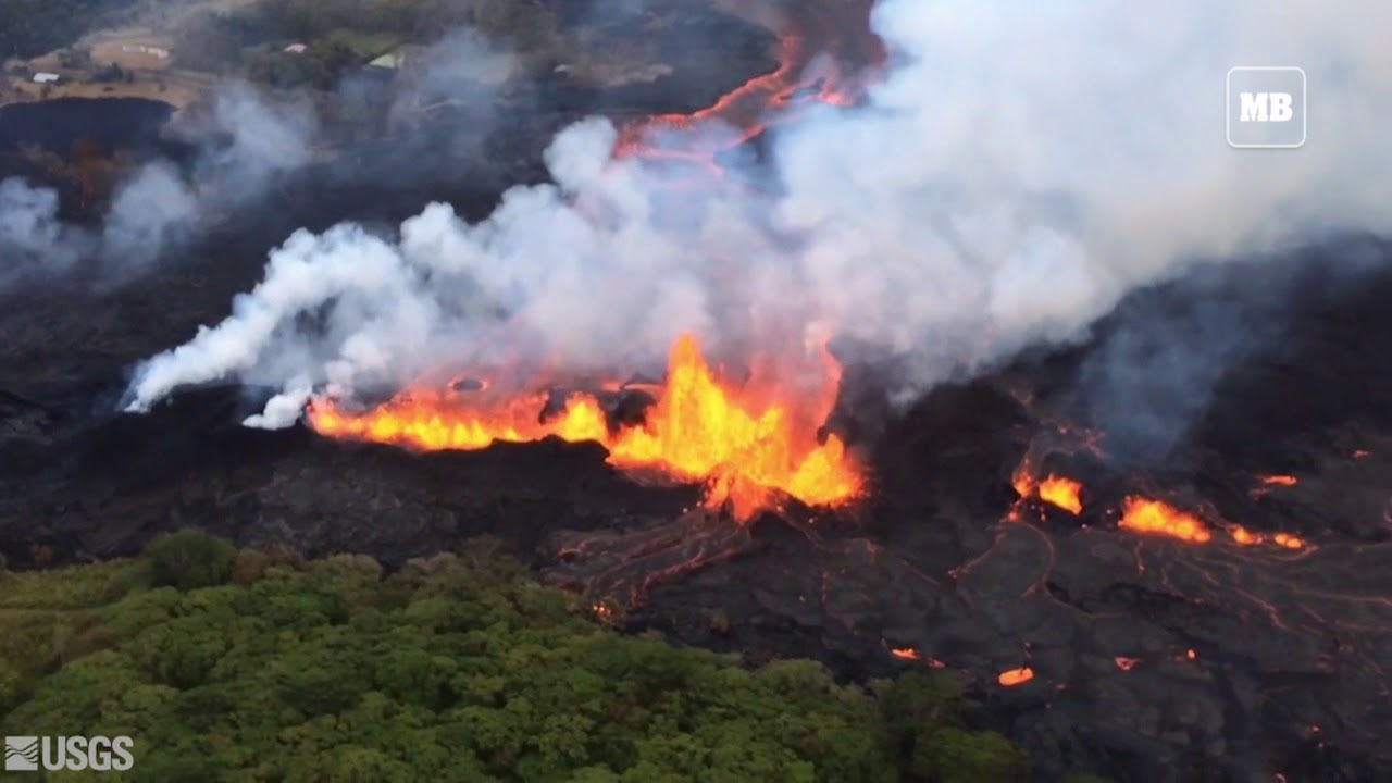 Lava splatters from fissures in Kilauea volcano in Hawaii