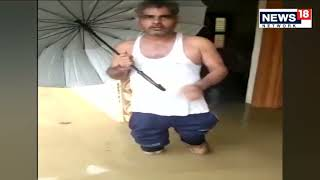 Viral Video | Haryana Hospital In Water, Doctors Treat Patients On Floating Infra  | CNN News18 Live