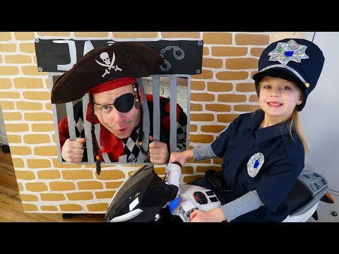Margo playing police with Toy Sportbike for the Cop LOCKED UP Jack in Jail Playhouse