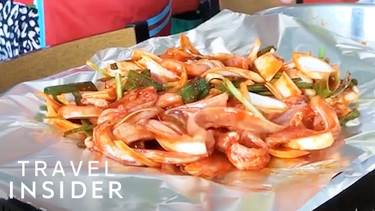 Seafood Wiggles On The Plate At South Korean Market