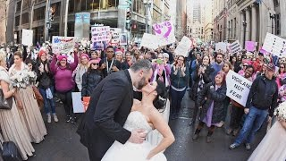 Repeat youtube video Photographer Snaps Incredible Wedding Photo Of Couple In Women's March
