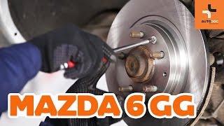 Kuinka vaihtaa taka jarrulevyt ja taka jarrupalat Mazda 6 GY -merkkiseen autoon OHJEVIDEO | AUTODOC