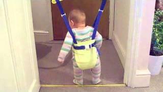 Baby jumping in doorway bouncer