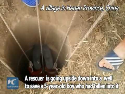 Rescuer goes upside down to save boy falled in central China water well