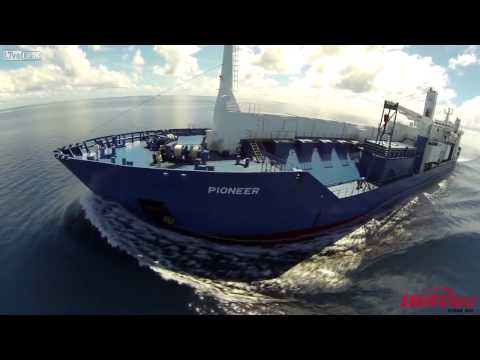 Quadcopter views of a cargo ship's ocean voyage