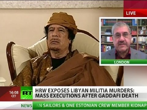 War crime? Gaddafi, son & dozens of loyalists executed by rebels
