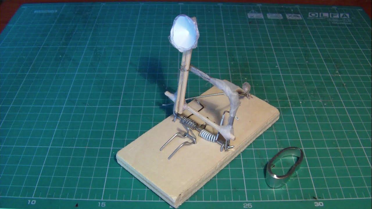 Very powerful homemade mini catapult - YouTube