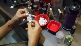 Newspaper nail art using Victoria Secret's , Secret Charm.
