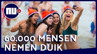 Duizenden trotseren koude water voor nieuwjaarsduik | NU.nl