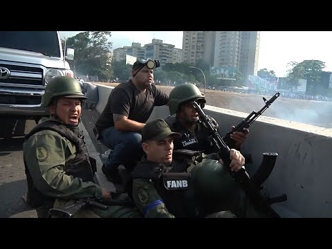 Troops loyal to Guaido take cover as shots fired