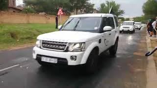 Sirens from Mama Winnie's funeral procession scream past