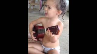 2 year old sings Jingle Bells while playing ukulele