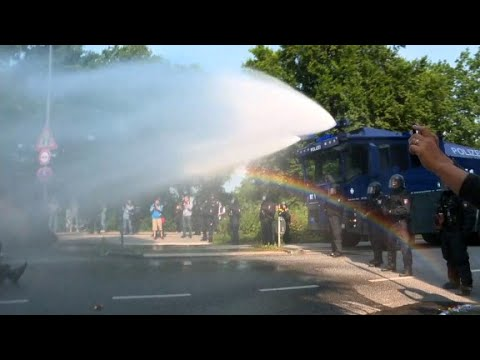 Download Police deploy water cannons on G20 protesters