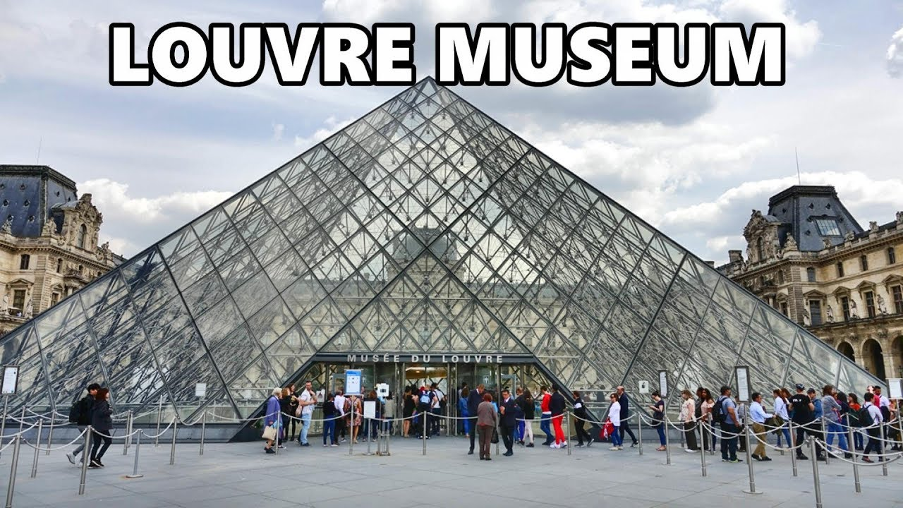 LOUVRE MUSEUM - PARIS . The museum's pyramid glass structure.