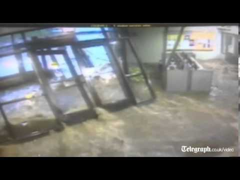 Dramatic footage: Flash flood rips off doors engulfing school lobby in Illinois