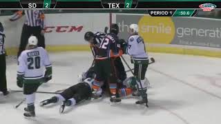 Stu Bickel shoves Justin Dowling to the ice before throwing a bunch of punches