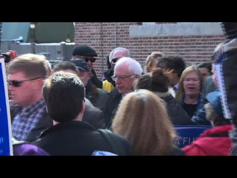 Bernie Sanders greeted by supporters on primary day in NH