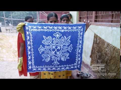 Indian girl showing batik material