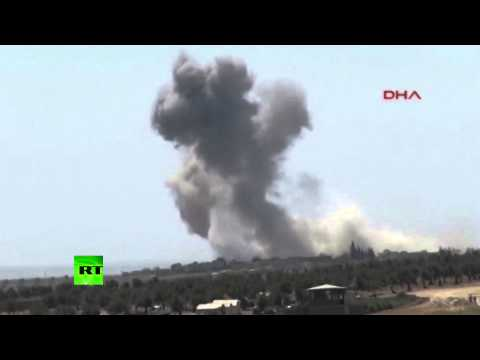 RAW: US-led anti-ISIS coalition strikes targets in Syria from Turkey