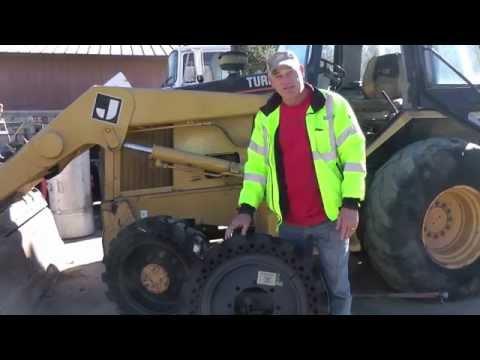Mclaren Solid Cushion Tires On CAT Backhoe