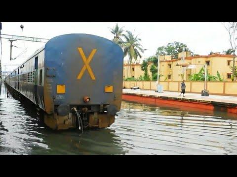 Train arriving at flooded Ernakulam Junction thumbnail