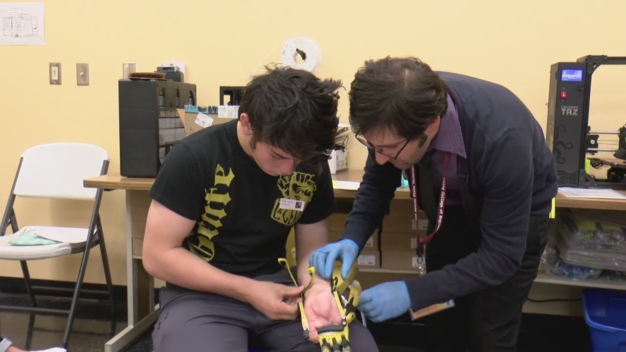 STEM students developing prosthetic limbs using 3D printer