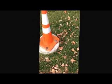 Caution cone bolted to cement, 337 XLA Wisconsin