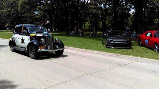 The Great Race Number 54 1936 Ford police car blaring it's sirens in Mason city Iowa