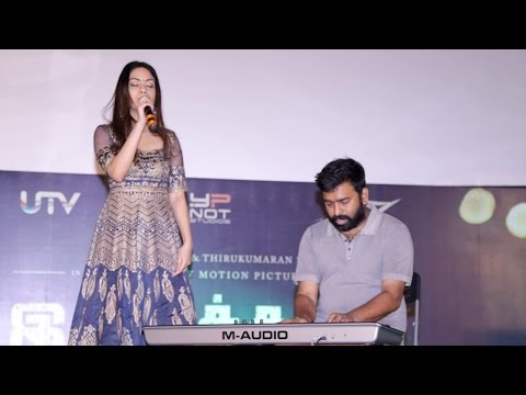 Santhosh Narayanan performs with his daughter at the audio launch of Irudhi Suttru Mp3