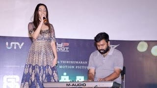 Santhosh Narayanan performs with his daughter at the audio launch of Irudhi Suttru