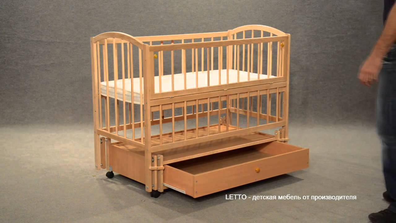 Детская кроватка с маятником фото