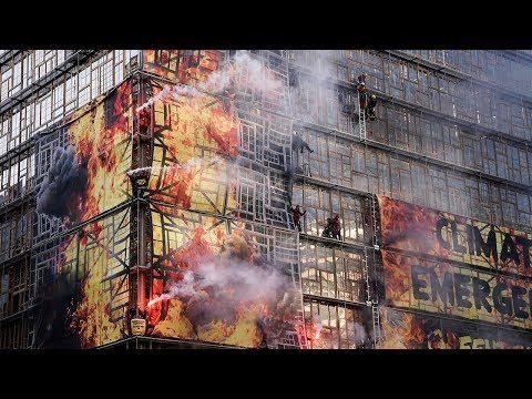 video: Greenpeace activists set off flares atop new EU headquarters as leaders gather for climate change talks