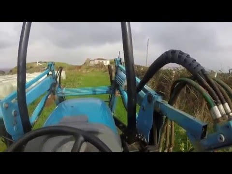Loading round bale silage with LS tractor R50