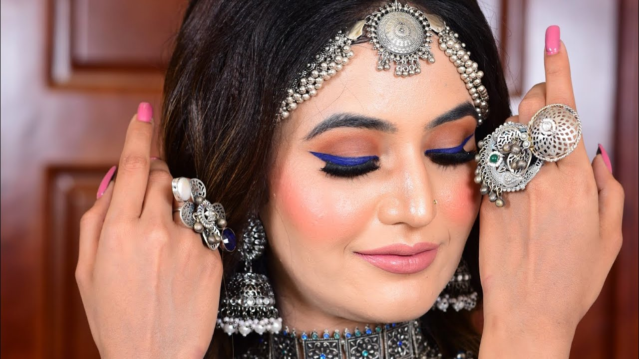 Sharp Blue Wing Liner, Oxidised silver jewellery for this stunning look ! Makeup by Parul Garg