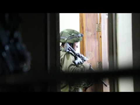 The israeli occupation force raid the house of my cousins Bassem and Jawaher abu Rahma.