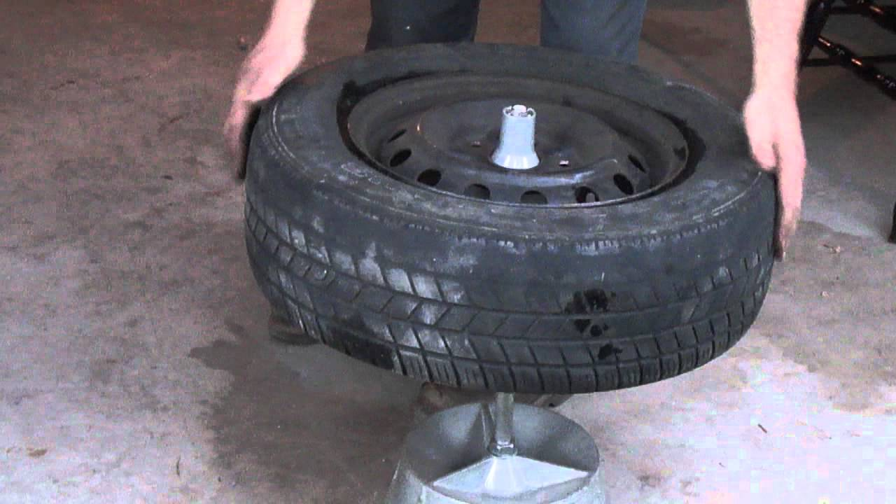 balancing a tire with a bubble balancer youtube rh youtube com Old Tractor Tires Old Time Weaver Tire Changer